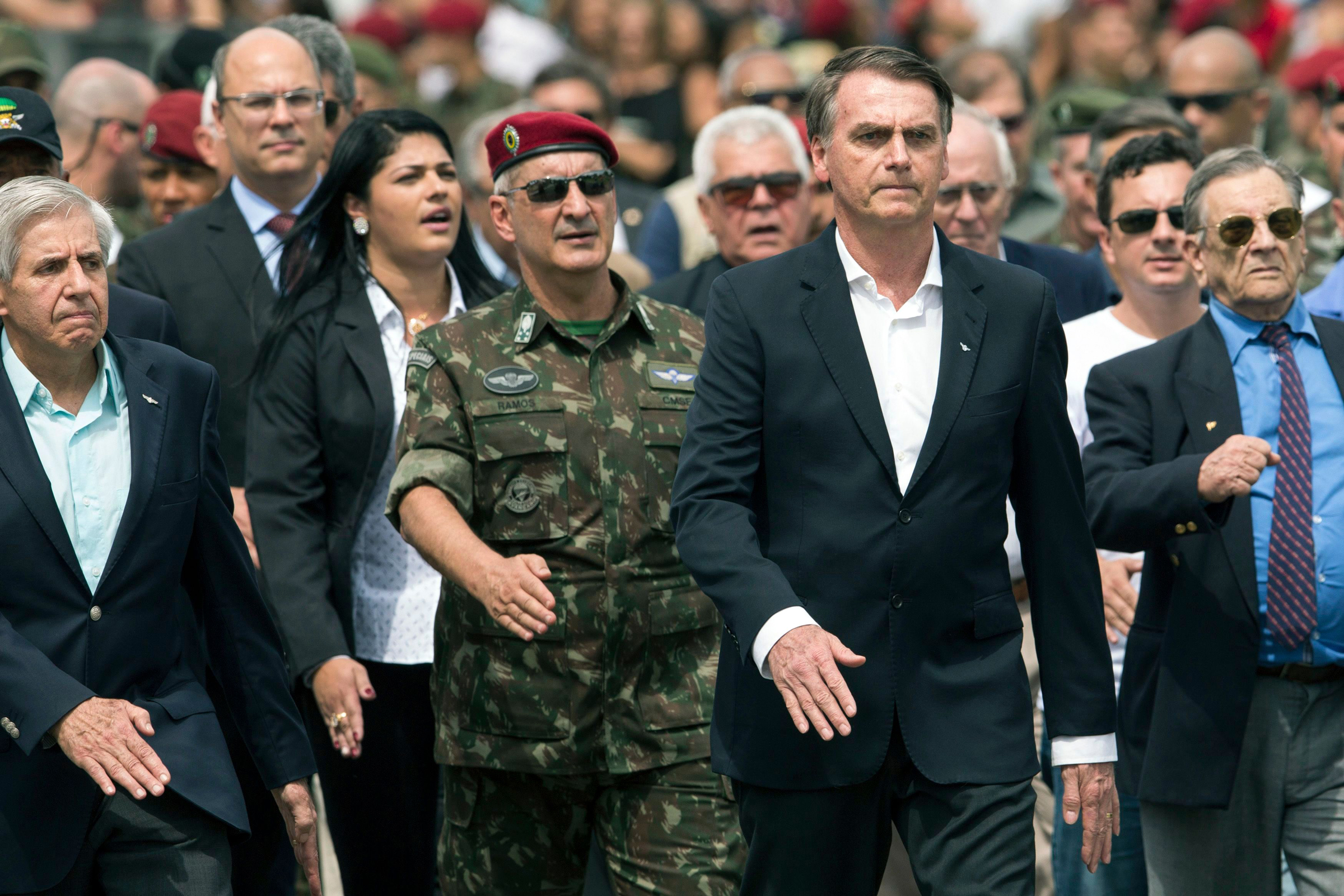 Brazil's President-elect Jair Bolsonaro, second from right, marches during a ceremony marking the 73rd anniversary of the Brazilian Paratrooper Infantry Brigade in Rio de Janeiro, Brazil, . Bolsonaro will be sworn in as Brazil's next president on Jan. 1Bolsonaro, Rio de Janeiro, Brazil - 24 Nov 2018