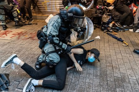 HONG KONG, CHINA - OCTOBER 6: Pro-democracy protesters arrested by police during a clash at a demonstration in Wan Chai district on October 6, 2019 in Hong Kong, China. Hong Kong's government invoked emergency powers on Friday to introduce an anti-mask law which bans people from wearing masks at public assemblies as the city remains on edge with the anti-government movement entering its fourth month. Pro-democracy protesters marked the 70th anniversary of the founding of the People's Republic of China in Hong Kong as one student protester was shot in the chest in the Tsuen Wan district during with mass demonstrations across Hong Kong. Protesters in Hong Kong continue to call for Chief Executive Carrie Lam to meet their remaining demands since the controversial extradition bill was withdrawn, which includes an independent inquiry into police brutality, the retraction of the word riot to describe the rallies, and genuine universal suffrage, as the territory faces a leadership crisis. (Photo by Anthony Kwan/Getty Images)