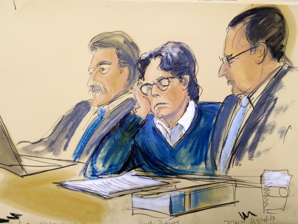 In this courtroom artist's sketch, defendant Keith Raniere, center, sits with attorneys Paul DerOhannesian, left, and Marc Agnifilo during closing arguments at Brooklyn federal court, in New York on June 18, 2019.