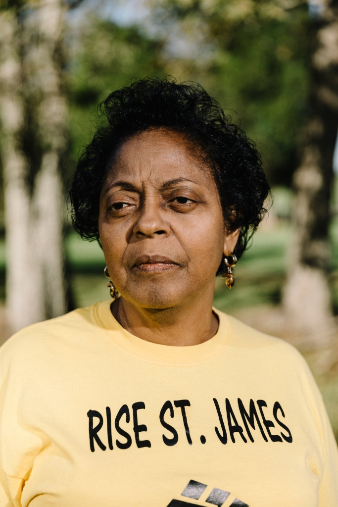 Sharon Lavigne stands in the front yard of her home located along the Mississippi River. Lavigne is the founder of Rise St. James, a local group of activists who have taken a stand against the petrochemical, oil, and gas plants that have proliferated throughout the stretch of the river known as Cancer Alley.