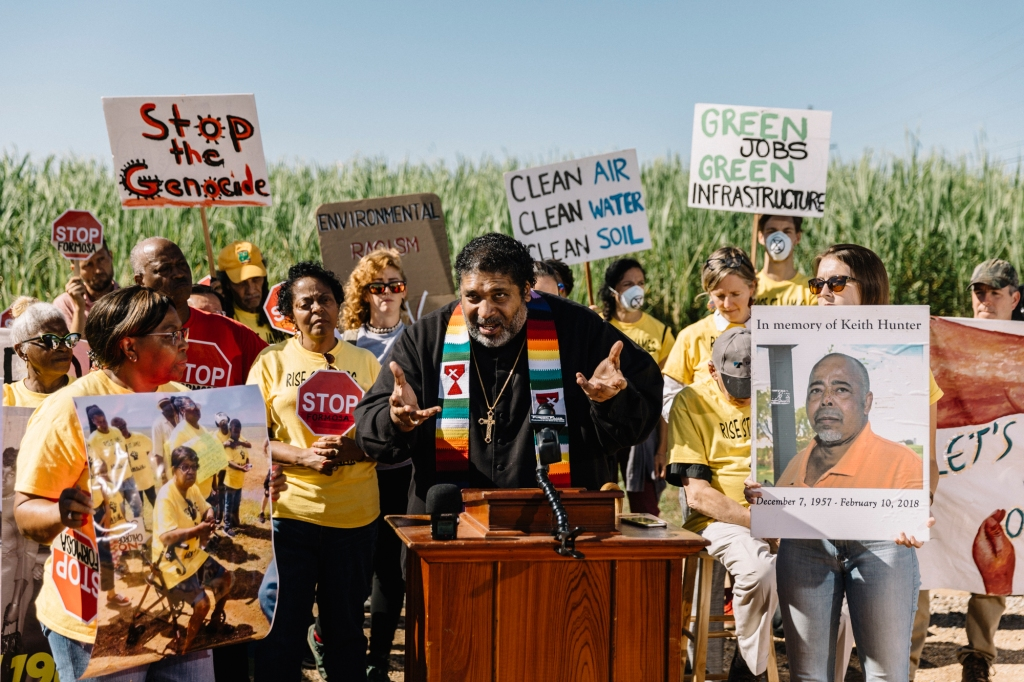 """St. James, LA - Oct. 23, 2019 - Rev. William Barber addresses news media, local residents, and environmental activists at the site of a planned Formosa factory. Barber joined """"The March Against Death Alley"""", a multi-day event coordinated by a coalition of environmental activists to raise awareness and advocate for residents who live nearby heavy industry along the river, as part of his Poor People's Campaign tour of the country."""