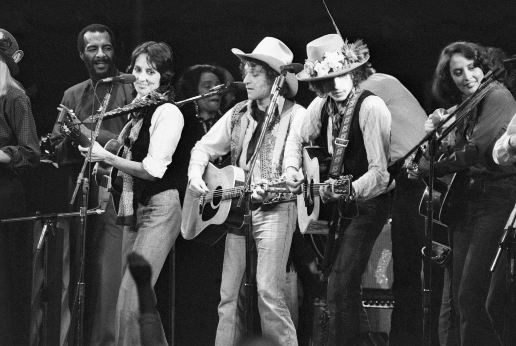 "Richie Havens, Joan Baez, Ramblin' Jack Elliott, Bob Dylan and others perform at a benefit concert for Rubin ""Hurricane"" Carter."