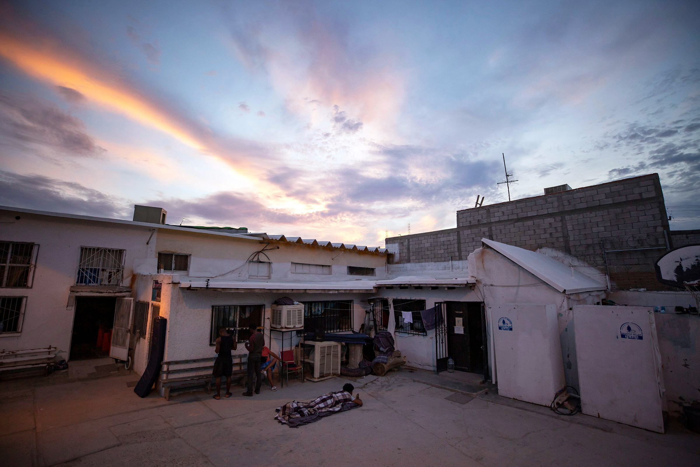 A migrant wakes up before sunrise at El Buen Pastor shelter for migrants in Cuidad Juarez, MexicoMexico Living in Limbo - 26 Jul 2019