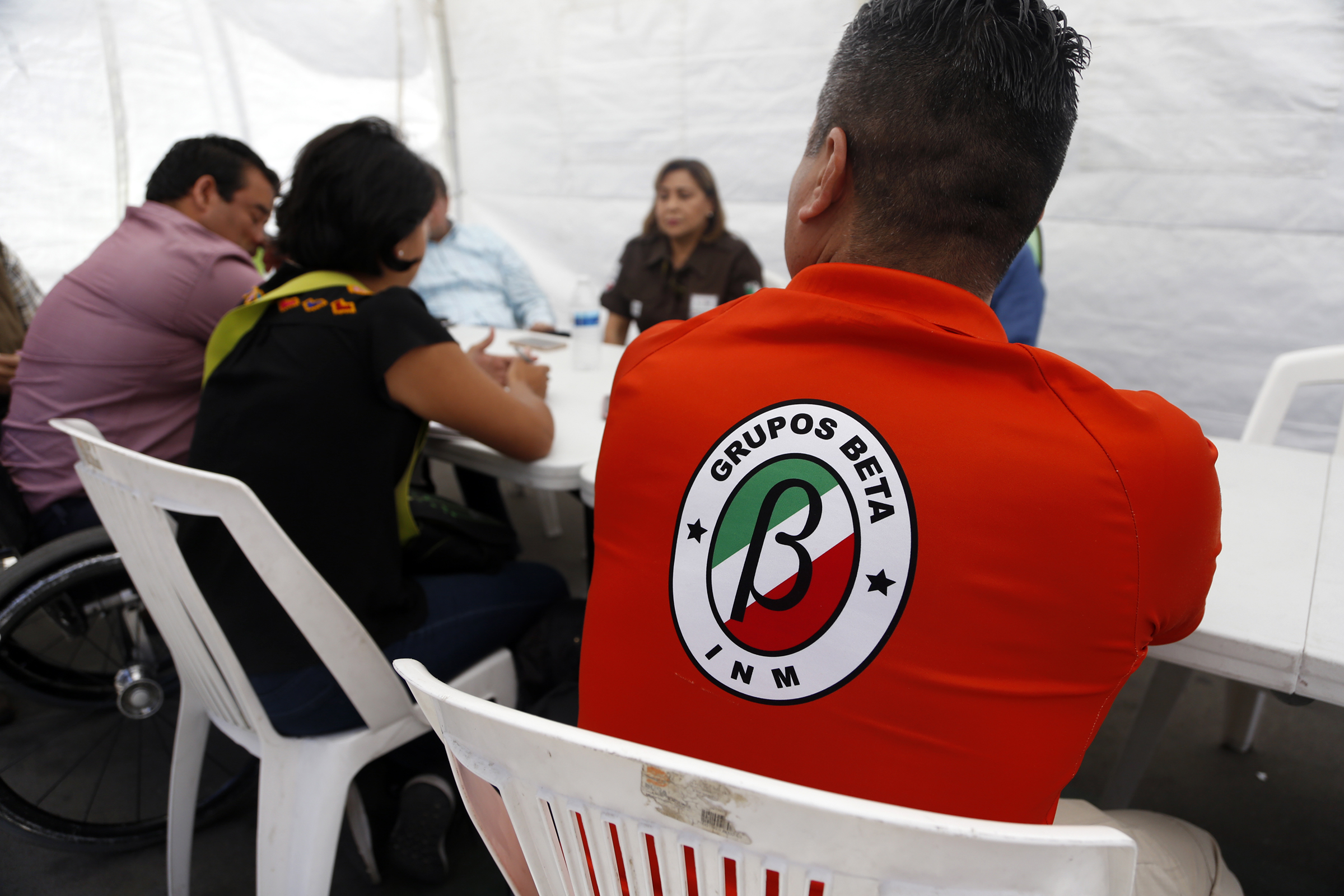 April 27, 2018 - Tijuana, Baja California, Mexico - Tijuana, Baja California, Mexico April 27th, 2018 | Various organizations meet outside Juventud 2000 shelter in Zona Norte. They discus the logistics for Sunday. A member of Grupo Beta, a border unit established by the Mexican government to protect migrants as they make their way north to the U.S. They participate in the meeting. | Alejandro Tamayo ¬© The San Diego Union Tribune 2018 (Credit Image: © Alejandro Tamayo/San Diego Union-Tribune via ZUMA Wire)