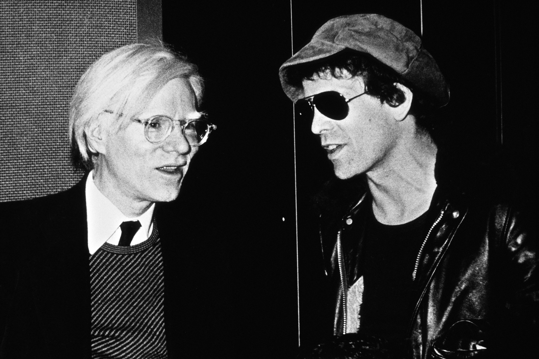 American pop artist Andy Warhol (1928 - 1987, left) with singer-songwriter Lou Reed (1942 - 2013), circa 1980. (Photo by Richard E. Aaron/Redferns/Getty Images)