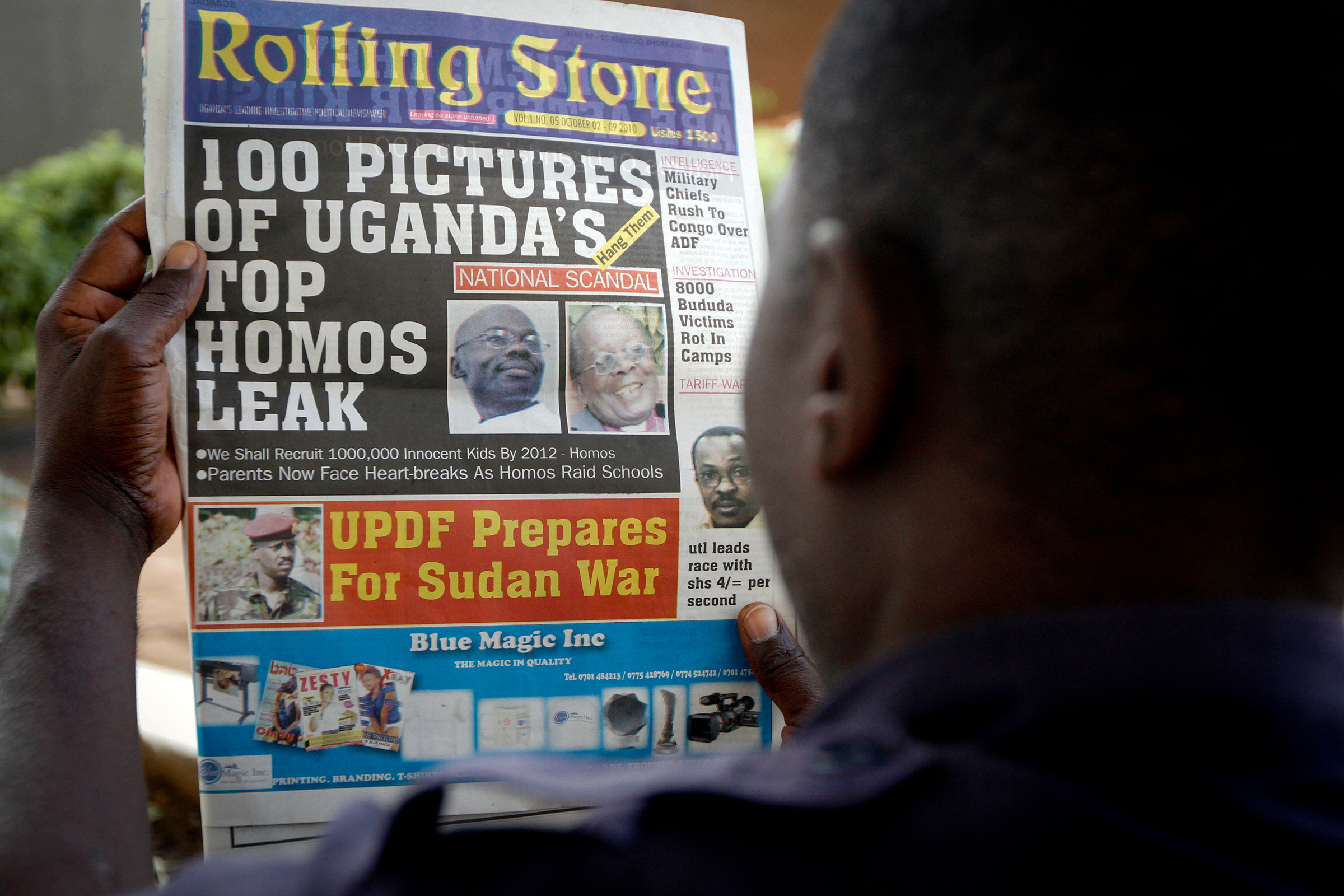 "A Ugandan man reads the headline of the Ugandan newspaper ""Rolling Stone"" in Kampala, Uganda., in which the papers reveals the identity of allegedly gay members of Ugandan society and calls for public punishment against those individuals. The ""Rolling Stone"" is a fairly new publication under the management of Giles Muhame, a Ugandan journalist..rights activitists say that at least four homosexuals have been attacked since a Ugandan newspaper published an article this month called ""100 Pictures of Uganda's Top Homos Leak _ Hang Them."" A year after a Ugandan legislator tried to introduce a bill that would have called for the death penalty for being gay, rights activists say homosexuals face a host of hostilityUganda Gays Attack, Kampala, Uganda"
