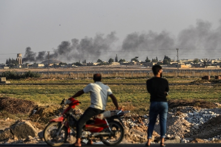 People watch Turkish-Syria border as smoke rises from targets inside Syria during bombardment by Turkish forces at Tal Abyad town as seen from Akcakale district in Sanliurfa, Turkey, 13 October 2019. Turkey has launched an offensive targeting Kurdish forces in north-eastern Syria, days after the US withdrew troops from the area.Turkey launches offensive targeting Kurdish forces in north-eastern Syria, Sanliurfa - 13 Oct 2019