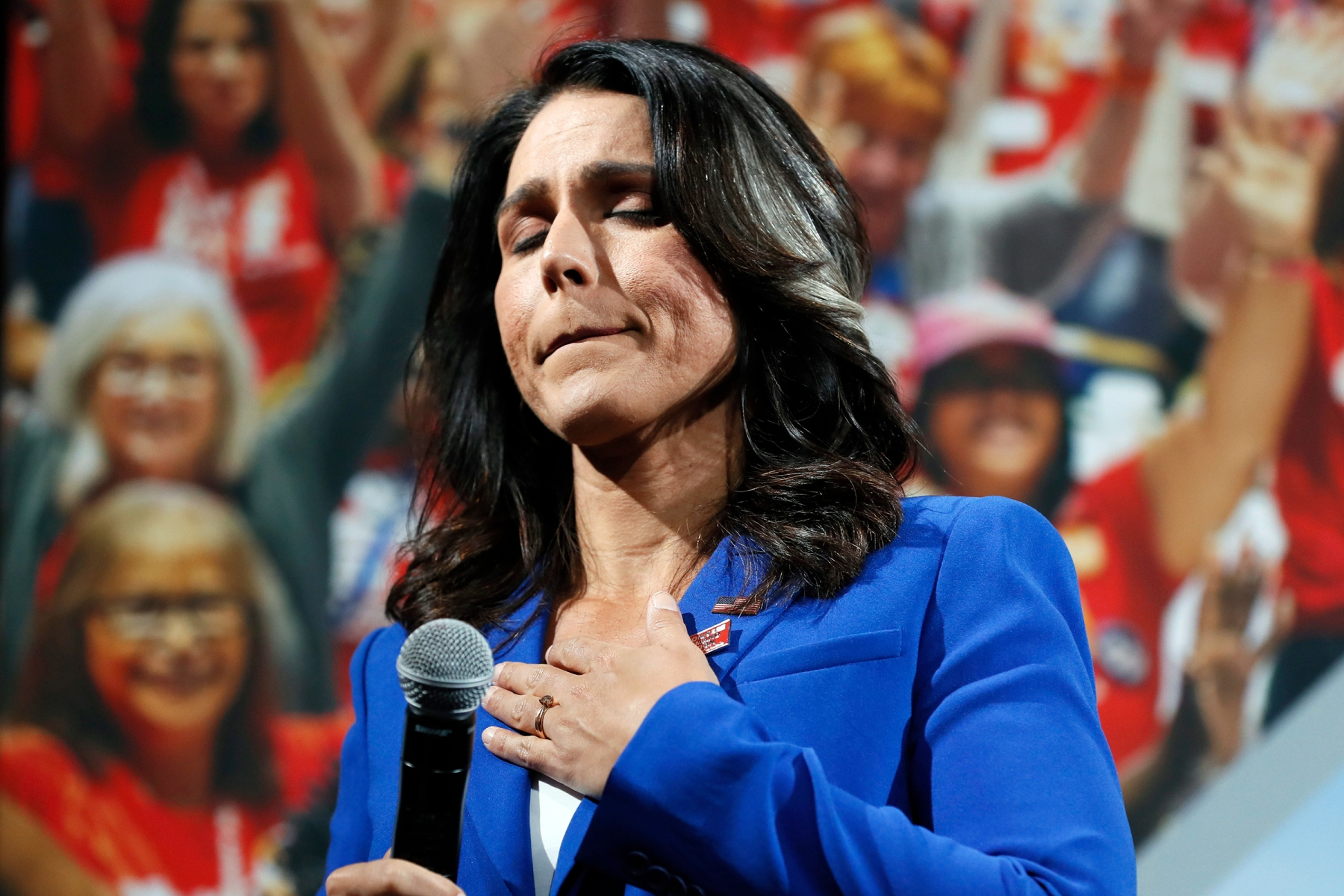 Democratic presidential candidate Rep. Tulsi Gabbard reacts as she listens to a question from the audience during the Presidential Gun Sense Forum, in Des Moines, IowaElection 2020 Tulsi Gabbard, Des Moines, USA - 10 Aug 2019