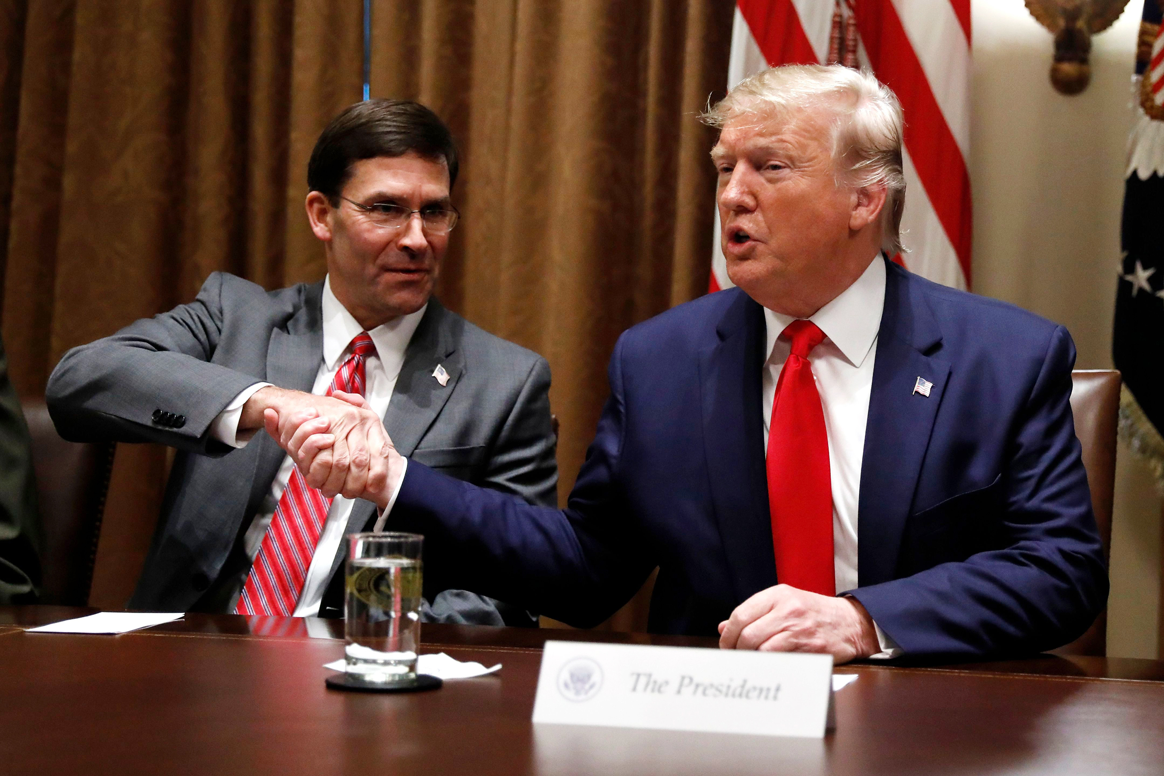 President Donald Trump shakes hands with Defense Secretary Mark Esper during a briefing with senior military leaders in the Cabinet Room at the White House in WashingtonTrump, Washington, USA - 07 Oct 2019