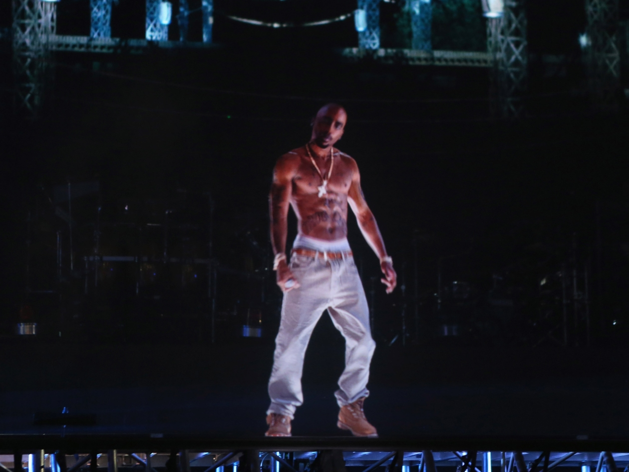 INDIO, CA - APRIL 15:  A hologram of deceased rapper Tupac Shakur performs onstage during day 3 of the 2012 Coachella Valley Music & Arts Festival at the Empire Polo Field on April 15, 2012 in Indio, California.  (Photo by Christopher Polk/Getty Images for Coachella)