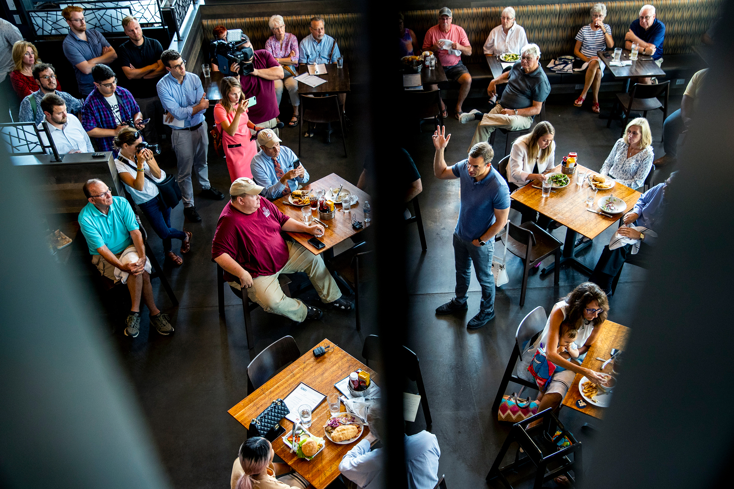 U.S. Rep. Justin Amash, I-Cascade Township, center, holds a constituent meeting at Rising Grinds Cafe, in Grand Rapids, Mich., on Wednesday, Aug. 21, 2019. (Cory Morse/The Grand Rapids Press via AP)