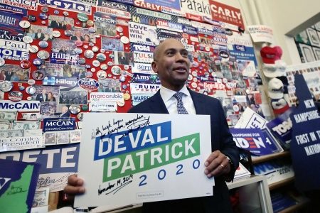 Democratic presidential candidate former Massachusetts Gov. Deval Patrick adds his campaign sign to pins, signs and bumper stickers of New Hampshire primary presidential contenders on display in the State House visitors center, in Concord, N.HElection 2020 Deval Patrick, Manchester, USA - 14 Nov 2019