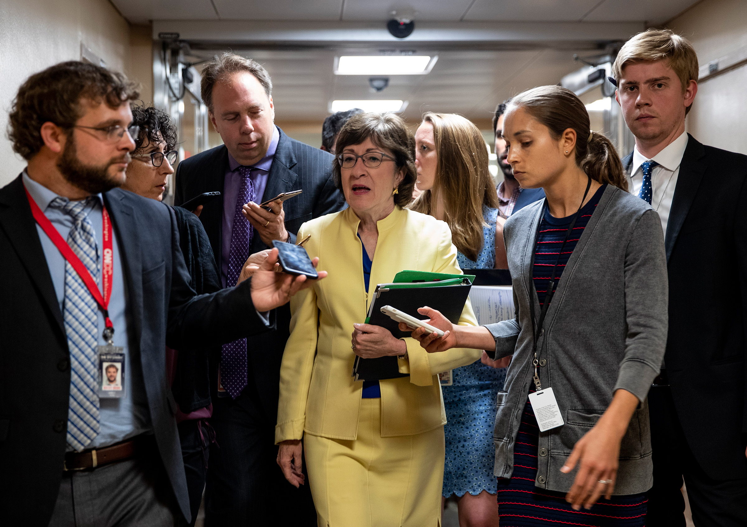 FILE -- Sen. Susan Collins (R-Maine) speaks to reporters while heading to the Senate floor at the Capitol in Washington, July 31, 2019. Congress is bracing this month for another round of bitter spending battles over President Donald Trump's promised border wall and his immigration agenda, with only three weeks remaining before the government runs out of money. (Anna Moneymaker/The New York Times)