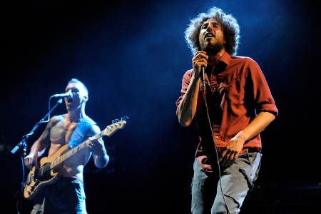 """Zack de la Rocha and Tim Commerford of the band Rage Against the Machine perform during their headlining set at the """"L.A. Rising"""" concert at the Los Angeles Coliseum."""