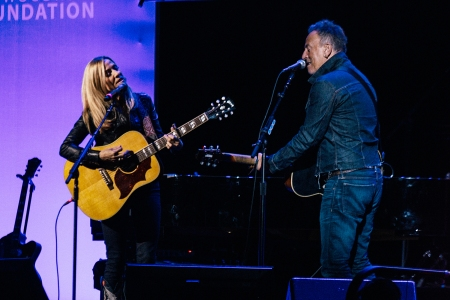 Sheryl Crow [L) and Bruce Springsteen [R) perform during the 13th Annual Stand Up For Heroes benefit at the Hulu Theater at Madison Square Garden in New York City on November 4, 2019