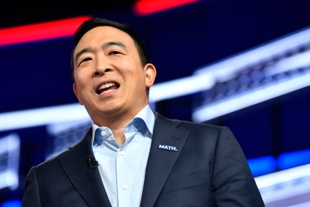 Andrew Yang's Staff Pulls Him Back From Spraying Whipped Cream Into Mouths of Kneeling Supporters