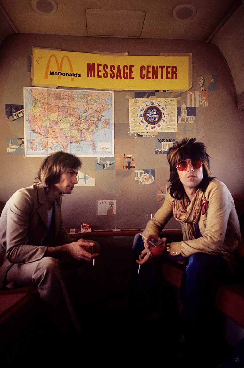 """Get off my cloud //Charlie Watts and Keith Richards on the Stones' touring plane in 1972. """"We were transitioning at this point into the celebrity culture,"""" Russell says. """"They were at the top of the pyramid. Behind me as I'm taking this picture is Truman Capote."""""""
