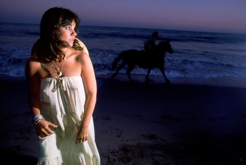 """Wild Horses // For the cover of 1976's Hasten Down the Wind, Russell shot Linda Ronstadt after sunset at her Malibu home. """"The horse,"""" he says, """"was a complete accident."""""""
