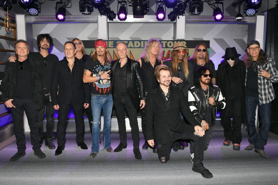 HOLLYWOOD, CALIFORNIA - DECEMBER 04: (L-R) Rick Allen, Tommy Lee, Vivian Campbell, Joe Elliott, Bret Michaels, Phil Collen, Rick Savage, Rikki Rockett, C.C. DeVille, Nikki Sixx, Vince Neil, Mick Mars, and Bobby Dall attend the Press Conference with Mötley Crüe, Def Leppard, and Poison announcing 2020 Stadium Tour on December 04, 2019 in Hollywood, California. (Photo by Kevin Winter/Getty Images)