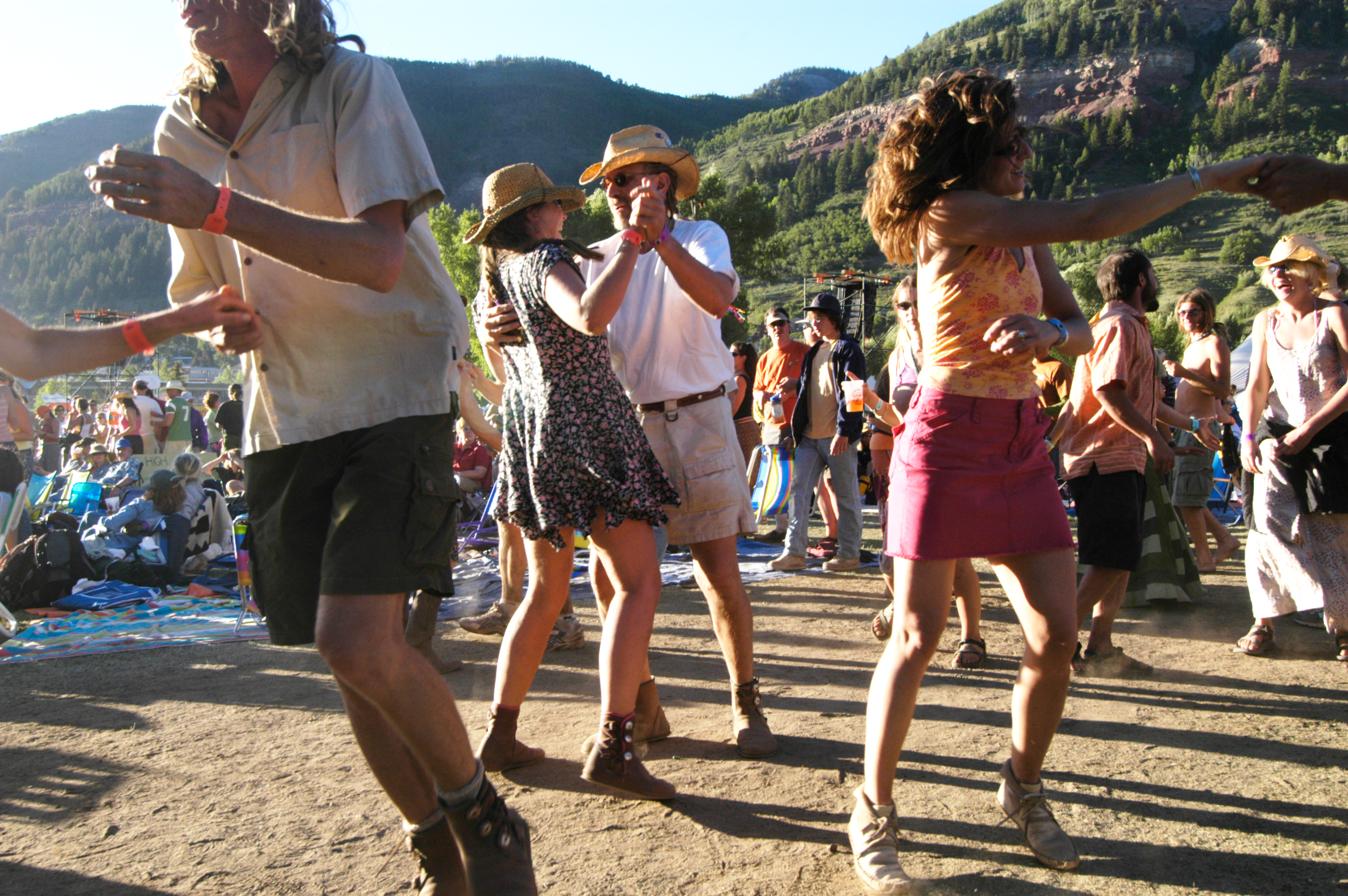 "An adorning crowd of 10,000 self proclaimed ""Festivarians"" dance to the music at the 31st Annual Telluride Bluegrass Festival, in Telluride, Colorado. (Photo by Tim Tadder/Corbis via Getty Images)"