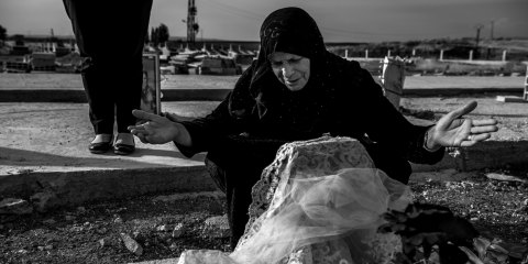 A colleague (TK name) of Hevrin Khalaf and Hevrin's mother (TK name) vist her grave at a cemetery on the outskirts of Al-Malikiyah (or Derik as it's known to Kurds), Syria on October 22, 2019. Hevrin Khalaf and her driver were assassinated by Turkish-backed Syrian militants on October 12th while driving on the M4 highway in northeastern Syria. She was a Syrian Kurdish political leader of the Future Syria Party.