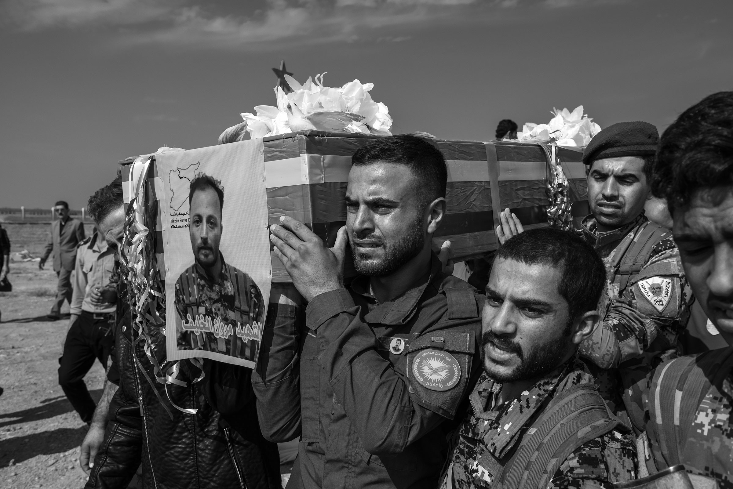 Men (TK man for man in middle) carry the coffin of a Syrian Democratic Forces member (TK) killed fighting Turkish-backed militants in northeastern Syria, in the town of Tel Hamis, Syria on October 21, 2019.