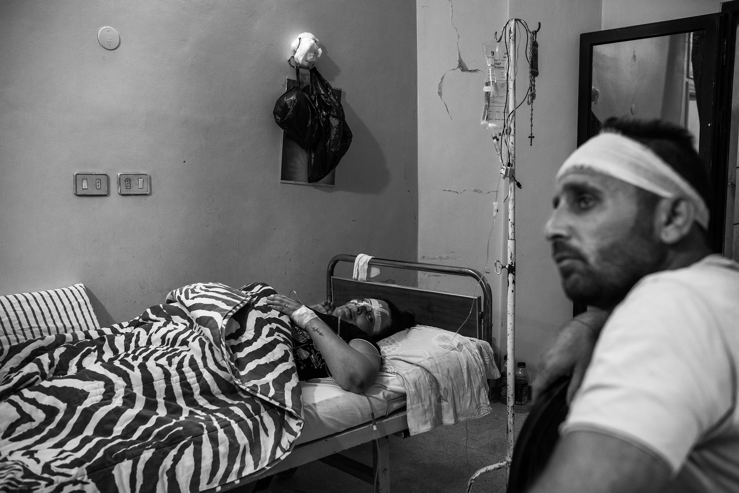 A Christian husband (TK name) and wife (TK name) injured by Turkish shelling sit in a hospital, in Qamishli, Syria on October 21, 2019.