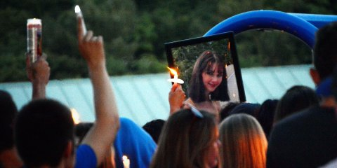 In this Monday, July 15, 2019 photo, family, friends and the community hold a vigil in Utica, N.Y., to remember 17-year-old Bianca Devins, of South Utica, who was killed by a man she'd met recently on Instagram, who then posted photos of her corpse online, police said Monday. (Greg Mason/Observer-Dispatch via AP)