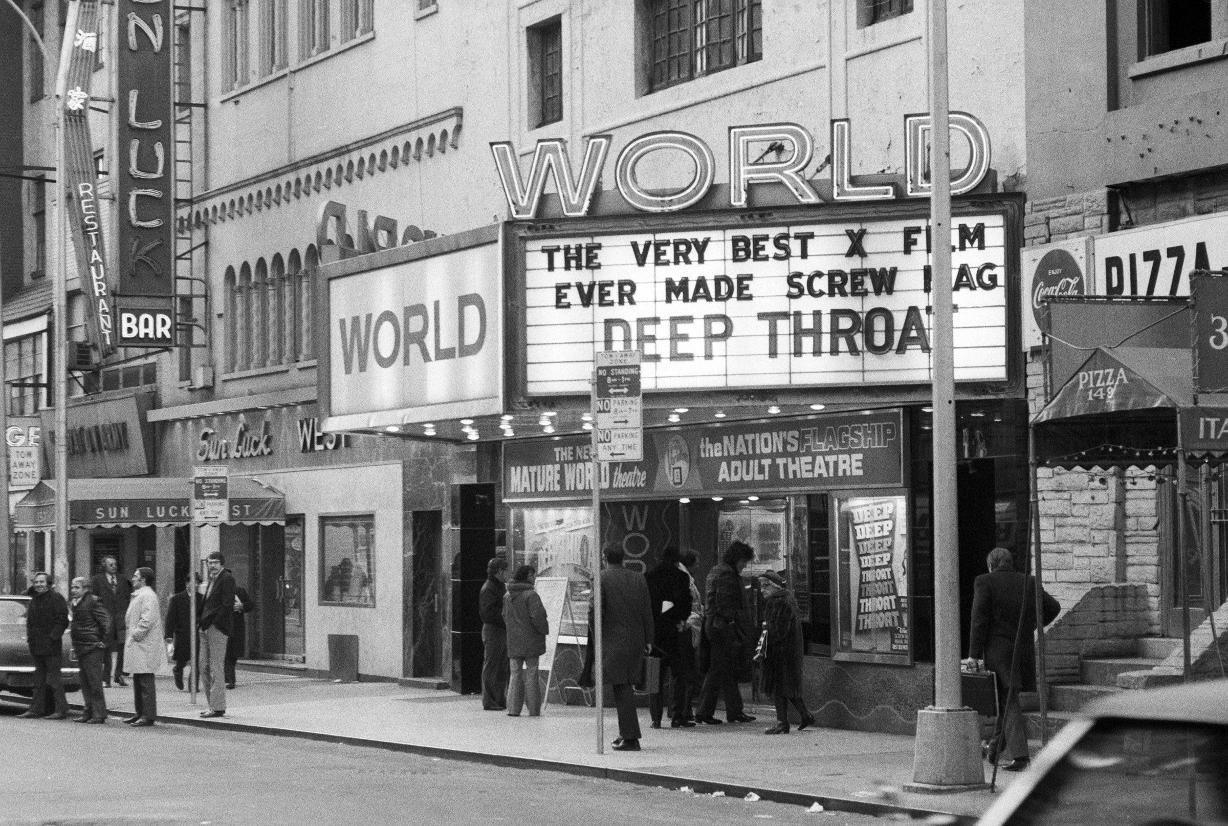 "(Original Caption) 2/1973-New York, New York-Marquee of The New Mature World Theatre which is showing the porno-film, ""Deep Throat."" West 49th Street."
