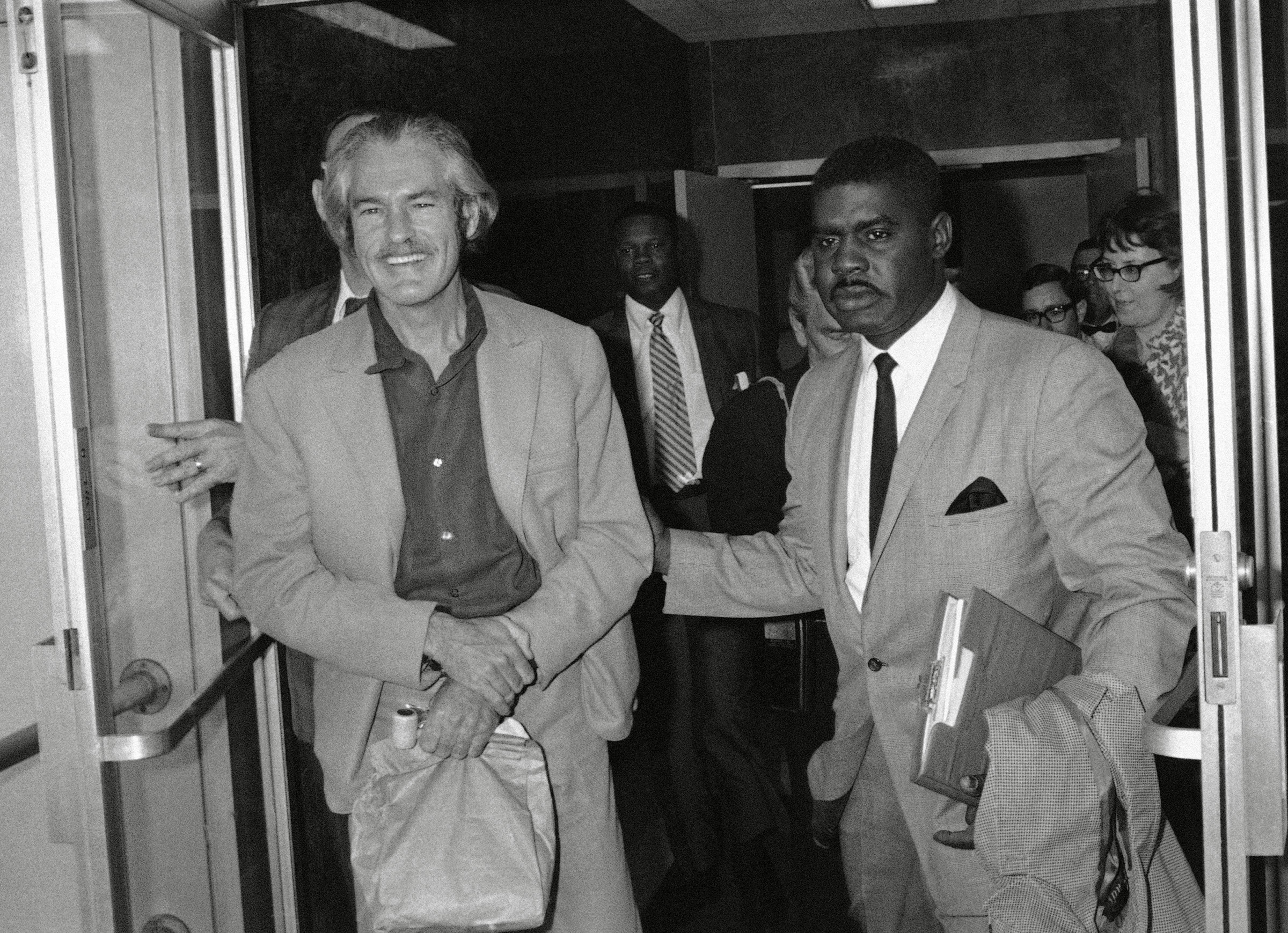 Timothy Leary Dr. Timothy Leary displays a big smile as he's escorted by U.S. Narcotics Bureau agents on his arrival at Los Angeles airport, . The former Harvard professor escaped in September, 1970 from prison in San Luis Obispo County, Calif., where he was serving a 10-year sentence on a drug conviction. Leary was expelled from Afghanistan January 17Dr. Timothy Leary, Los Angeles, USA