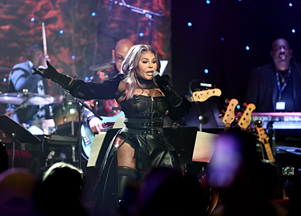 "BEVERLY HILLS, CALIFORNIA - JANUARY 25: Lil' Kim performs onstage during the Pre-GRAMMY Gala and GRAMMY Salute to Industry Icons Honoring Sean ""Diddy"" Combs on January 25, 2020 in Beverly Hills, California. (Photo by Alberto E. Rodriguez/Getty Images for The Recording Academy)"