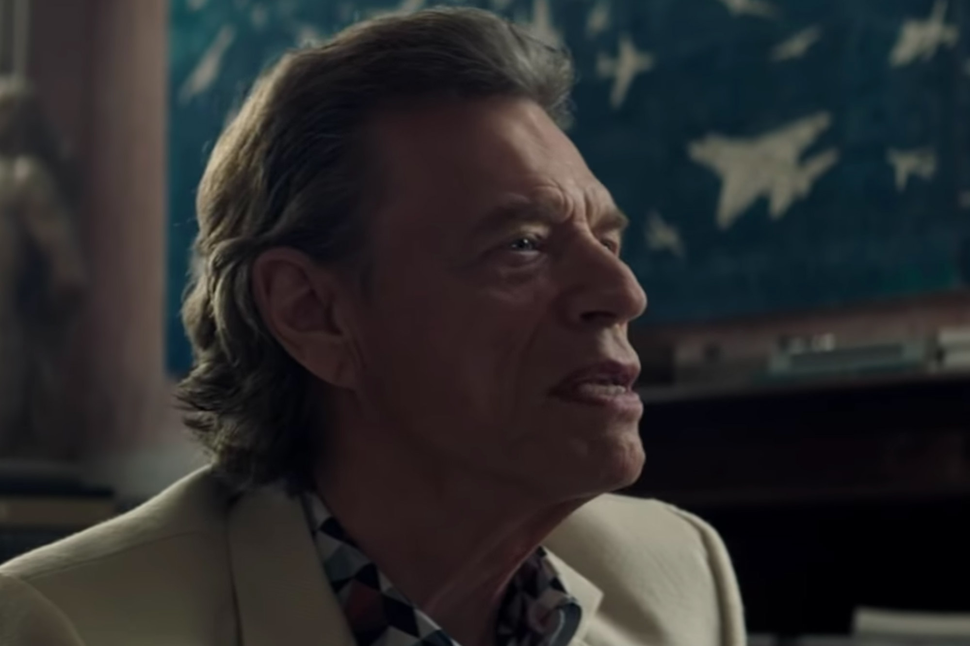 See Mick Jagger Portray Scheming Gallery Owner in 'Burnt Orange Heresy' Trailer