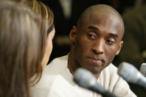 Kobe Bryant (R) looks at his wife Vanessa during a press conference where Bryant admitted to adultery but not sexual assault in response to the news earlier that charges will be pressed against him for one felony count of sexual assault, in Los Angeles on July 18th, 2003.