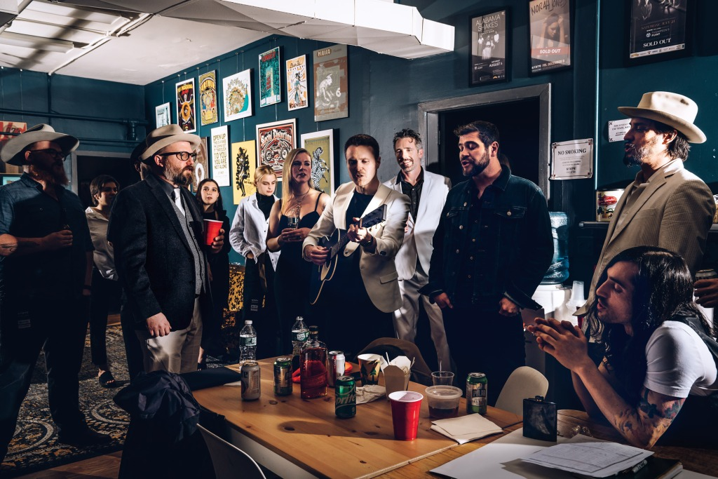 Band members of Spencer & The Walrus, warm up backstage in the Green Room of The State Theater, before the first of three shows in Portland, Maine on Nov 29th 2019.