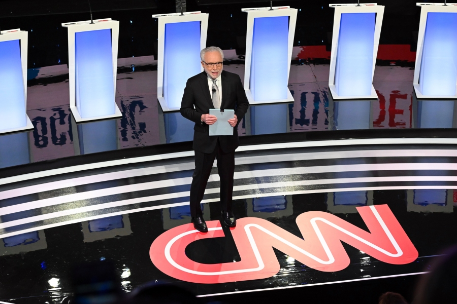 CNN journalist Wolf Blitzer arrives on stage to moderate the seventh Democratic primary debate of the 2020 presidential campaign season co-hosted by CNN and the Des Moines Register at the Drake University campus in Des Moines, Iowa on January 14, 2020. (Photo by Robyn Beck / AFP) (Photo by ROBYN BECK/AFP via Getty Images)