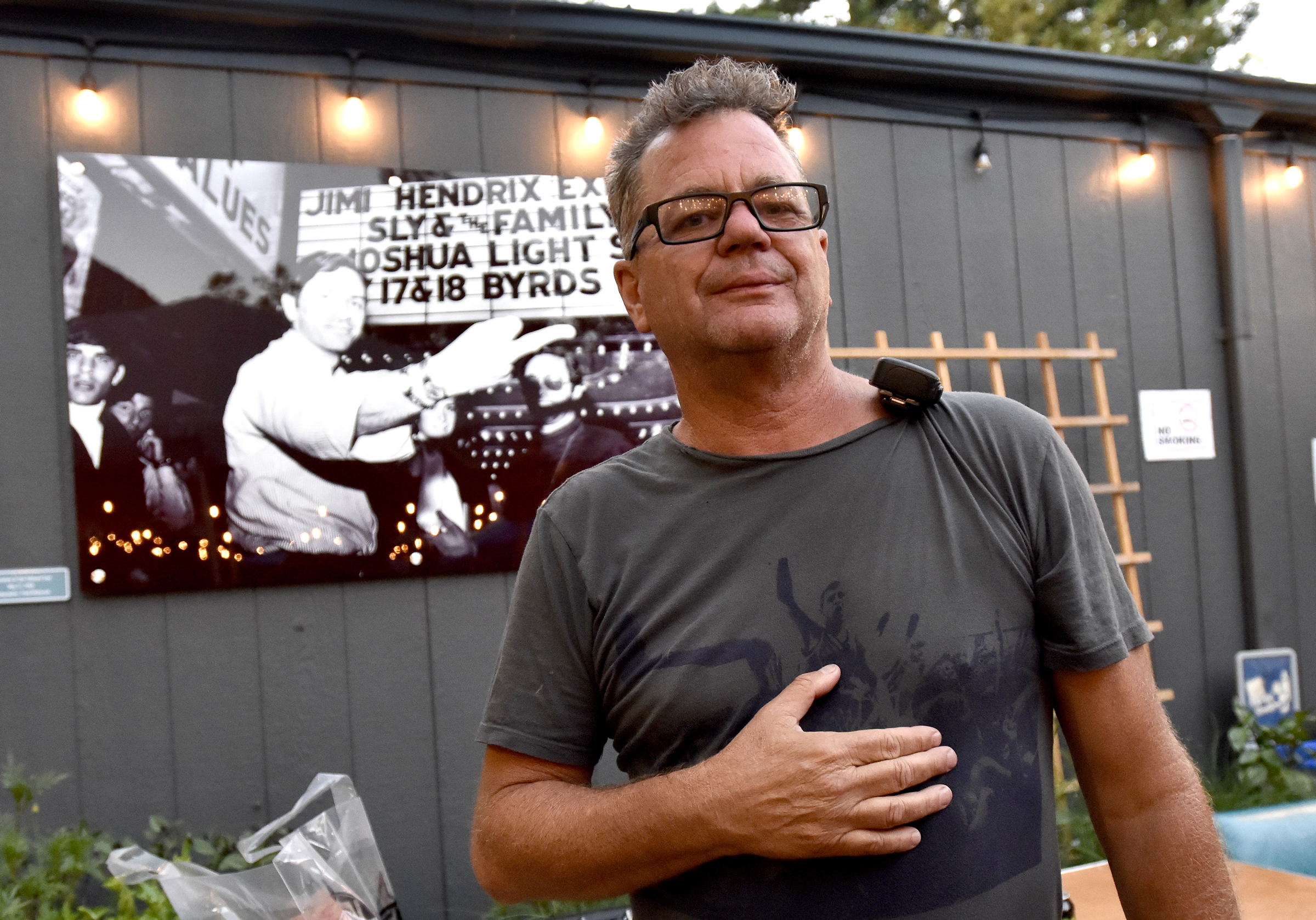MOUNTAIN VIEW, CALIFORNIA - JULY 20: Founder the Vans Warped Tour Kevin Lyman poses in front of a photograph of Bill Graham at the Vans Warped Tour 25th Anniversary on July 20, 2019 in Mountain View, California. (Photo by Tim Mosenfelder/Getty Images)