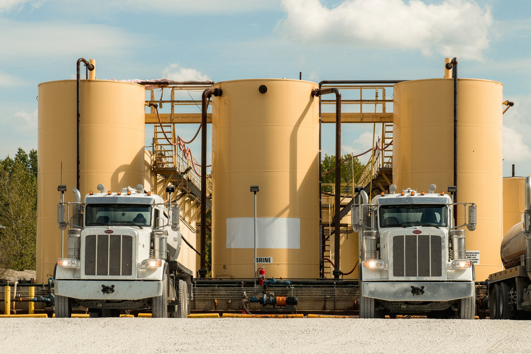 October 2, 2019: Brine trucks unload waste water at an Injection well in Cambridge, OH. George Etheredge for Rolling Stone