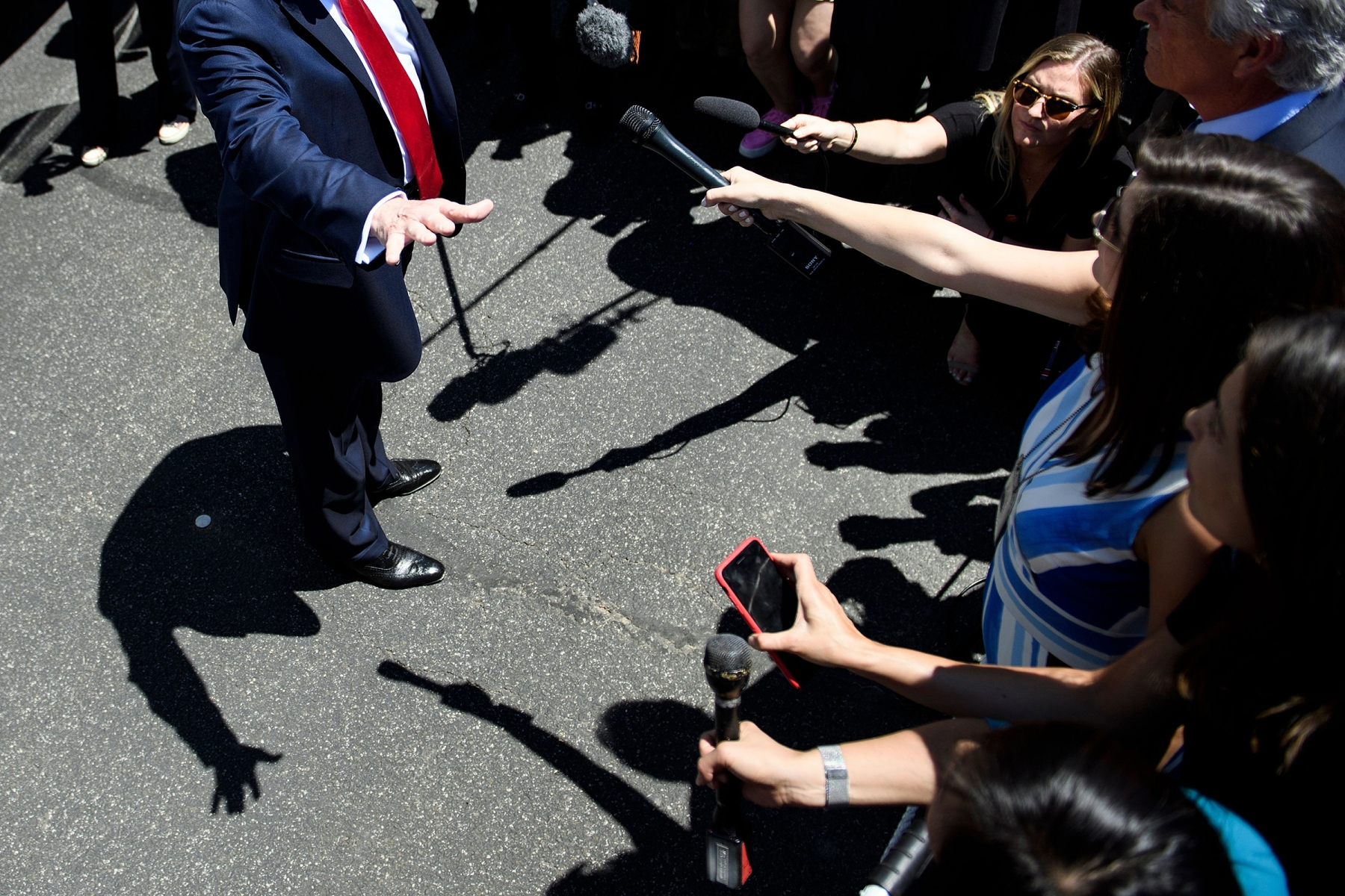 US President Donald Trump talks to the press during the 3rd Annual Made in America Product Showcase  on the South Lawn at the White House in Washington, DC, on July 15, 2019. (Photo by Brendan Smialowski / AFP)        (Photo credit should read BRENDAN SMIALOWSKI/AFP via Getty Images)