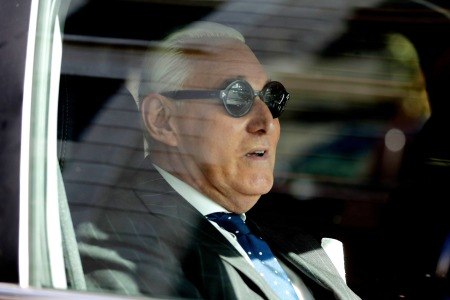 Roger Stone sits in a vehicle while leaving federal court Washington.