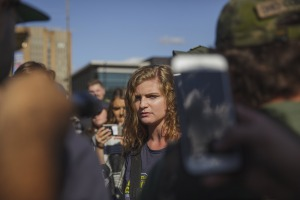 September 29, 2018 - Kent, Ohio, United States - Kaitlin Bennett, a a squad of Three Precenter Milita members and a wall of police, tried to debate counter protesters.Kaitlin Bennett, a former student of Kent State University, lead an open carry protest on her former campus. The Three Precenters came in as bodyguards for Bennett and her group Liberty Hangout.  On September 29, 2018 in Kent, Ohio, USA. (Credit Image: © Shay Horse/NurPhoto/ZUMA Press)