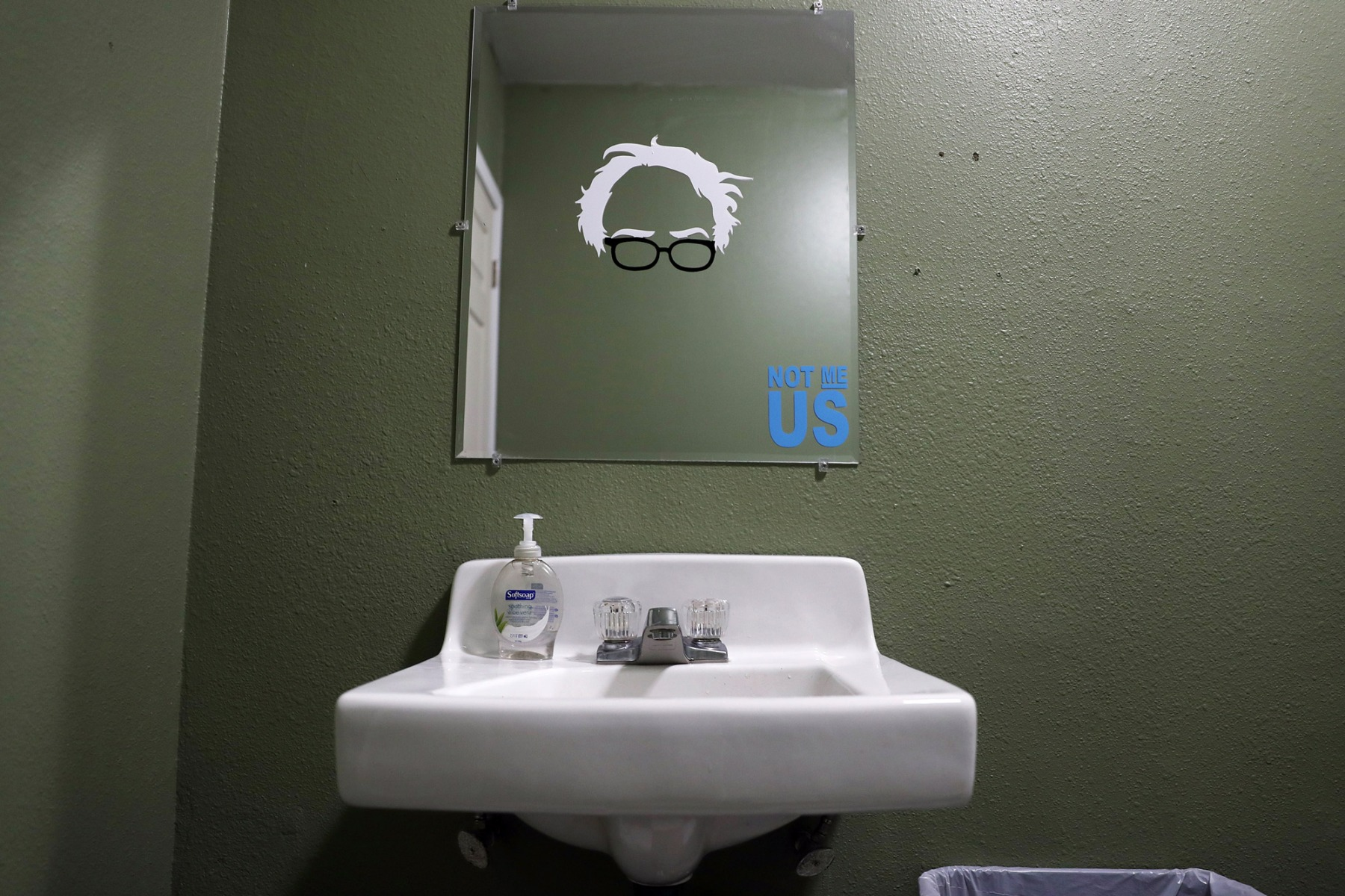 CEDAR RAPIDS, IOWA  - FEBRUARY 02:  A cutout of the eyeglasses and hair of Democratic presidential candidate Sen. Bernie Sanders (I-VT)  is stuck on a mirror at a campaign field office on February 02, 2020 in Cedar Rapids, Iowa. Iowa's first-in-the-nation caucuses will be held on February 3. (Photo by Joe Raedle/Getty Images)