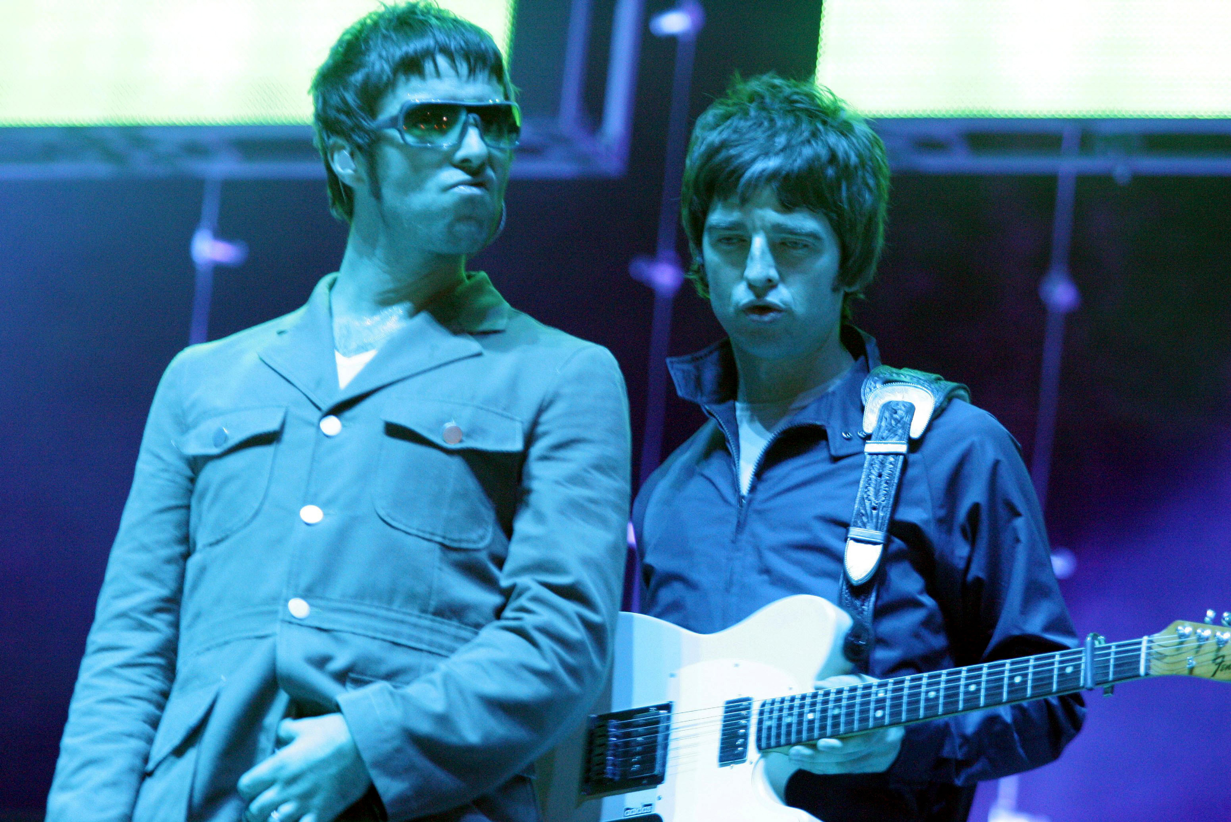 Liam Gallagher and Noel Gallagher perform at V Festival on August 21st, 2005.