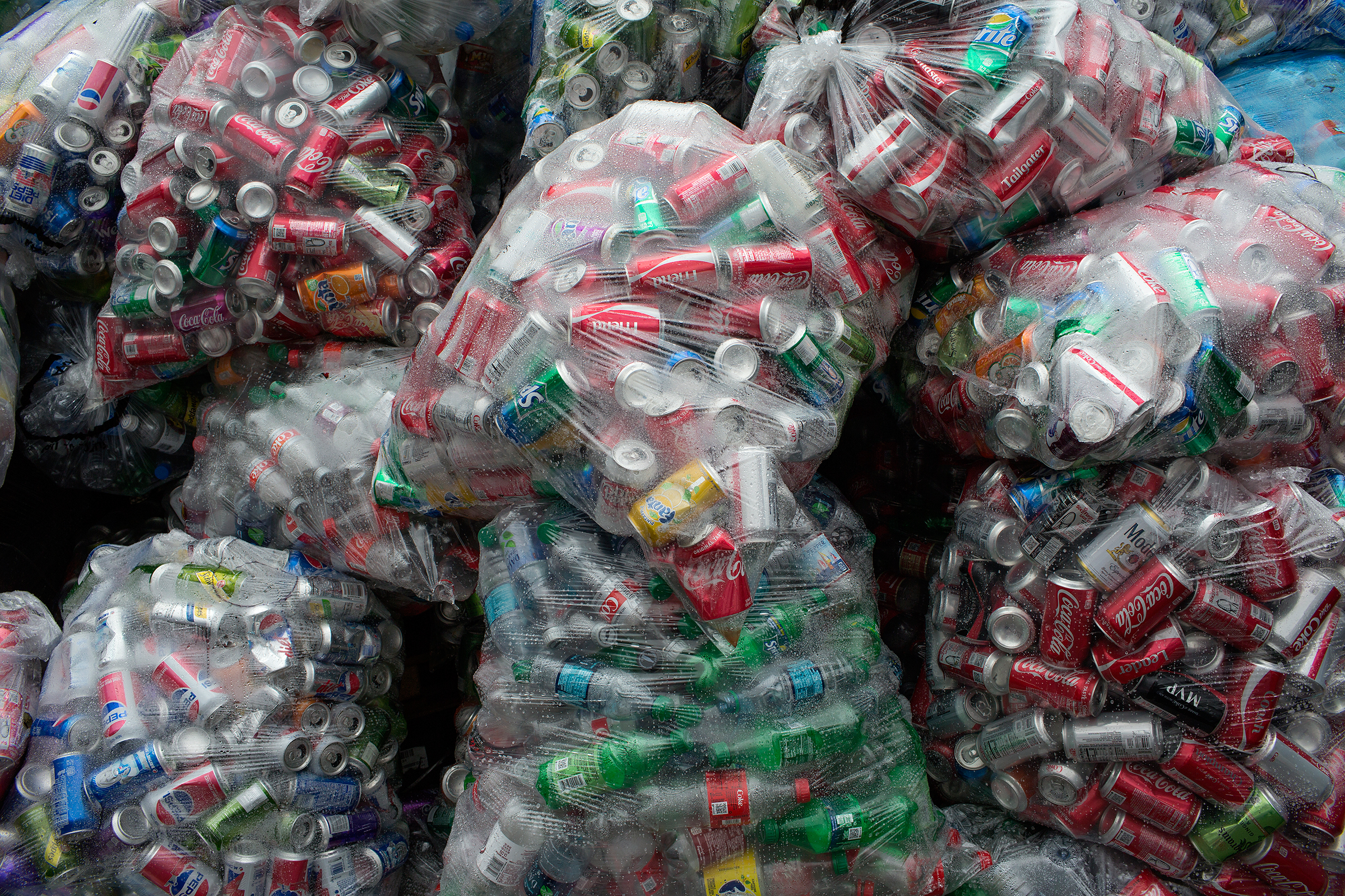 BROOKLYN, NY- JULY 25: Cans and bottles collected by street caners are sorted and bagged, awaiting pick up, a a recycling cooperative on July 25, 2018 in Bushwick, Brooklyn. (Photo by Andrew Lichtenstein/Corbis via Getty Images)