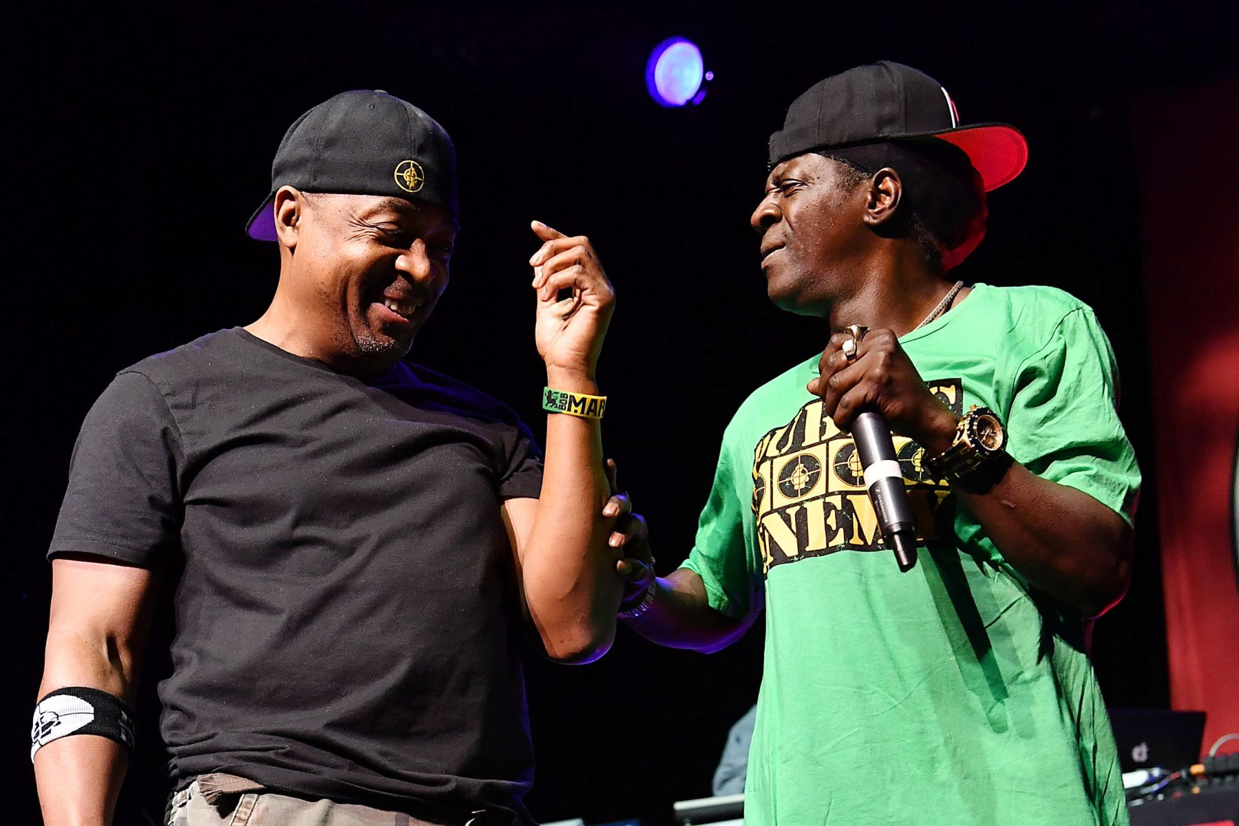 Rappers Flavor Flav, right, and Chuck D of the band Public Enemy perform at the O2 Arena in LondonBritain Public Enemy Concert, London, United Kingdom