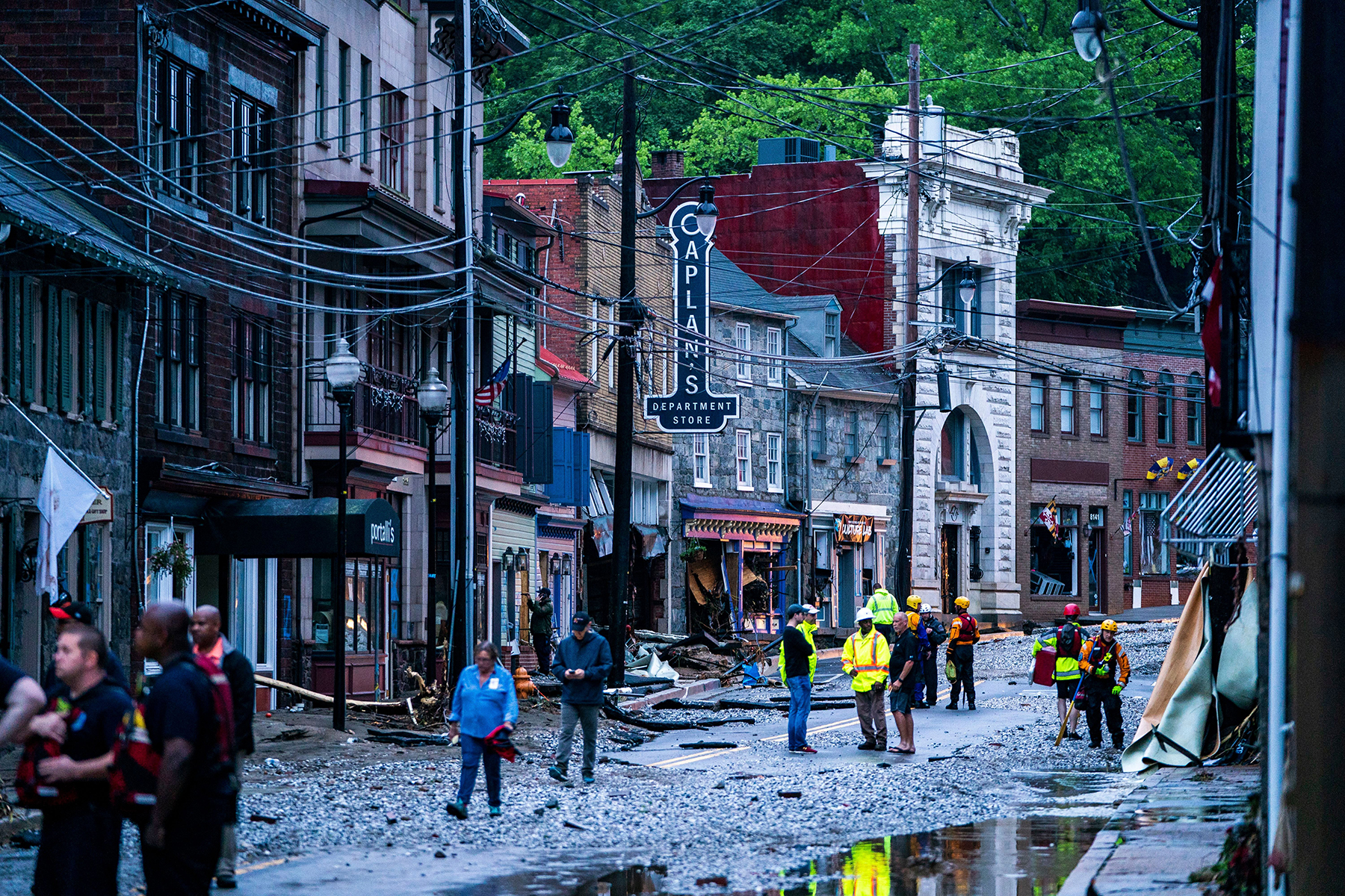 Rescue personnel examine damage on Main Street after a flash flood rushed through the historic town of Ellicott City, Maryland, USA, 27 May 2018. The National Weather Service stated as much as 9.5 inches of rain fell in the area.Flash floods ravage Ellicott City Maryland, USA - 27 May 2018