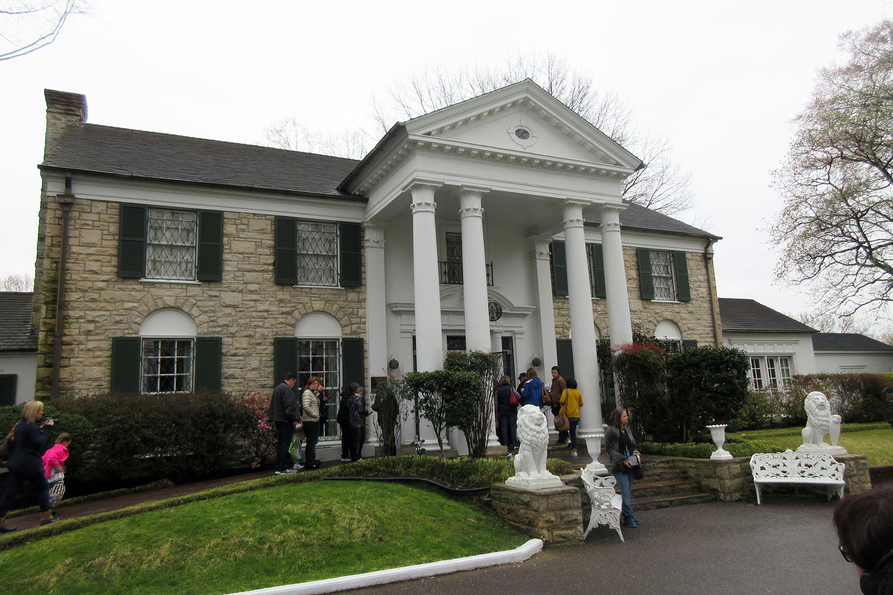 This photo shows visitors getting ready to tour Graceland in Memphis, Tenn. Elvis Presley bought the mansion _ which is small by 21st century standards _ in 1957 and lived there until his death 20 years laterTravel-2 Days in , Memphis, USA - 13 Mar 2017
