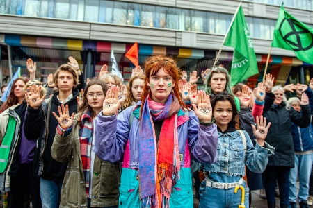THE HAGUE, NETHERLANDS, DECEMBER 20, 2019:Several climate activists with eyes painted in their palms during the demonstration.People from several climate organisations gathered with eyes painted on their hands symbolising 'We are watching you'. From there they walked to the Tweede Kamer, to demand radical climate action. In front of the Tweede Kamer, the group Extinction Rebellion carried out the performance Blood of our children is on the governments hands.- PHOTOGRAPH BY Ana Fernandez / Echoes Wire/ Barcroft Media (Photo credit should read Ana Fernandez / Echoes Wire / Barcroft Media via Getty Images)