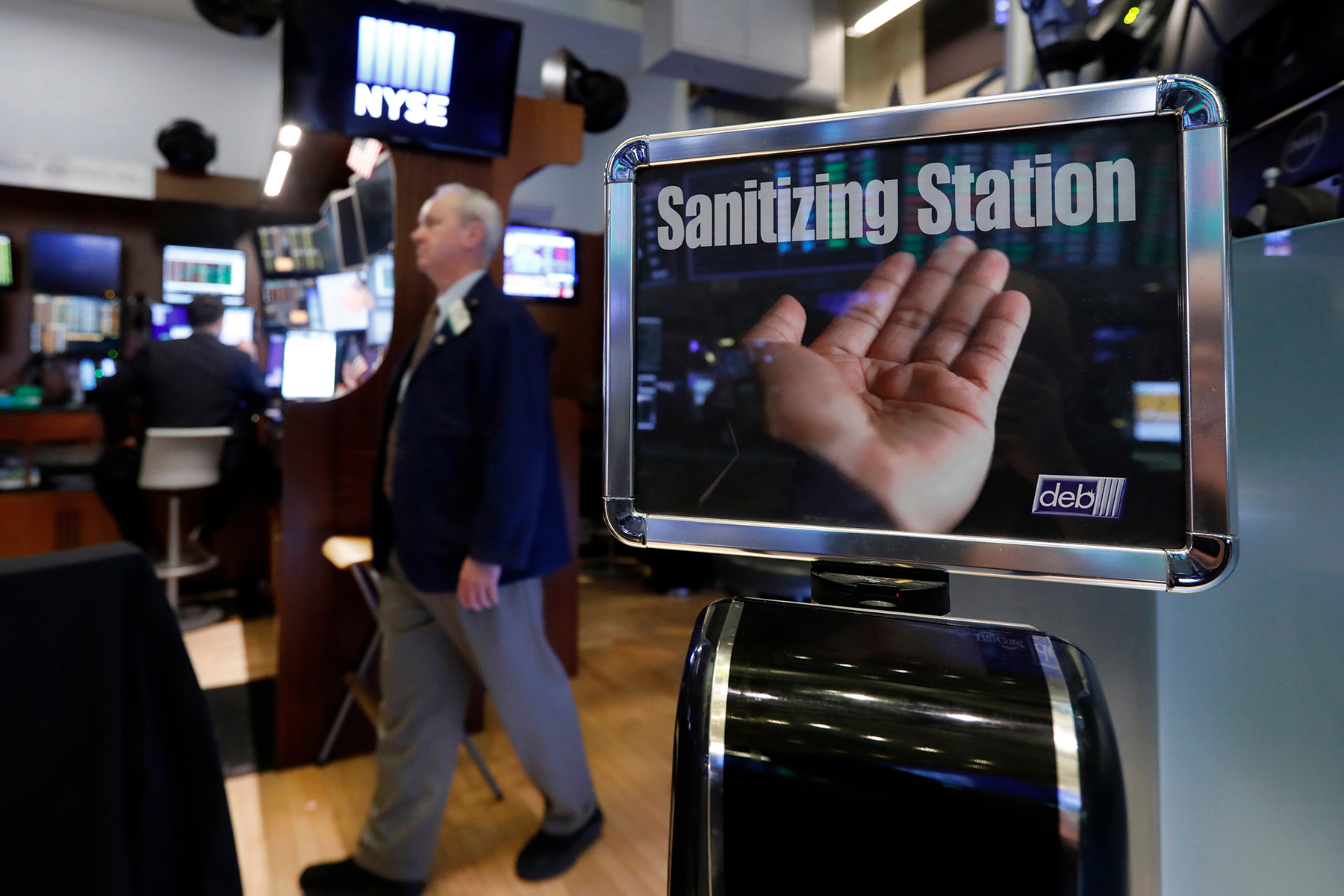 "A trader passes a hand sanitizing station on the floor of the New York Stock Exchange, . Federal Reserve Chairman Jerome Powell noted that the coronavirus ""poses evolving risks to economic activityVirus Outbreak Economy, New York, USA - 03 Mar 2020"