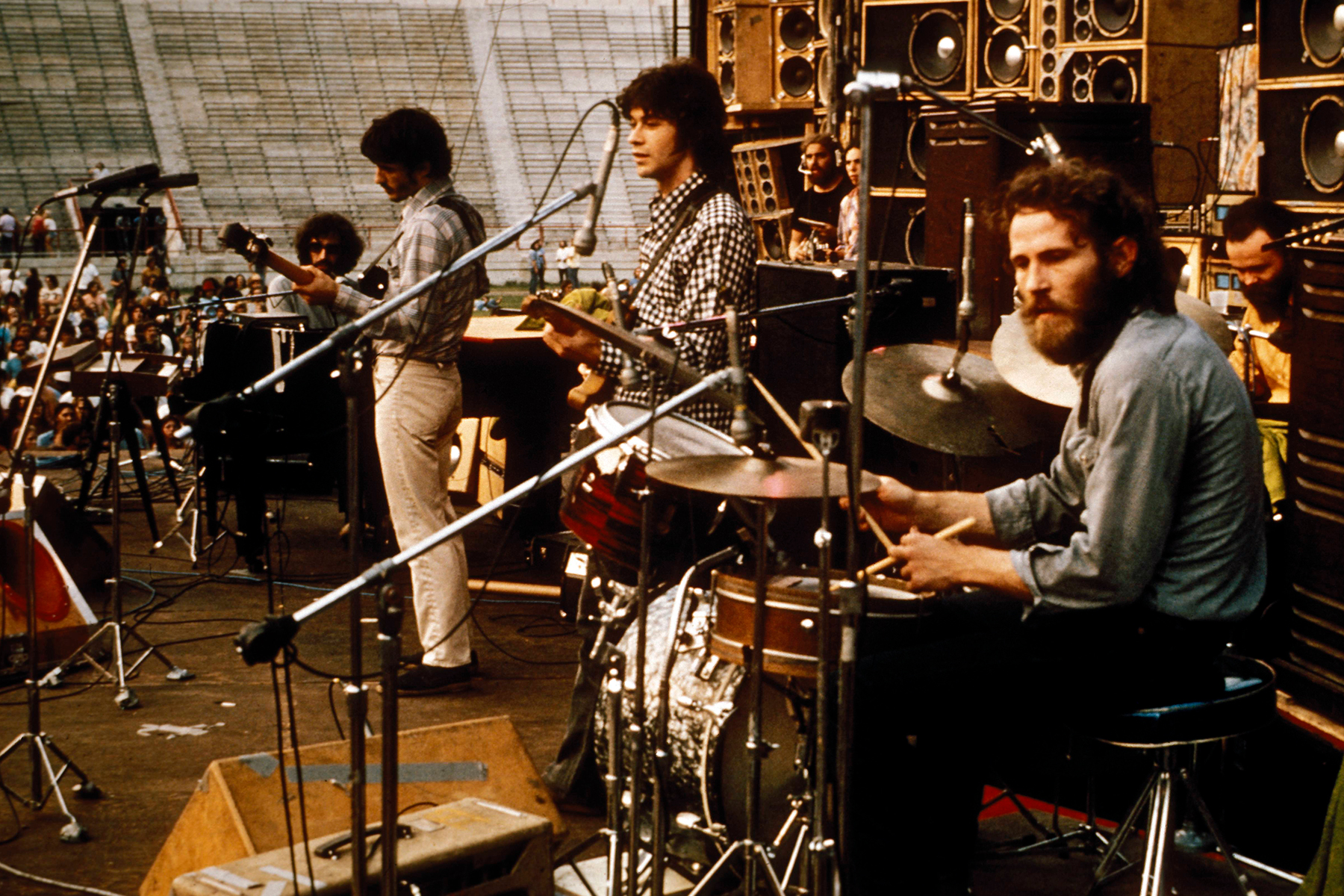 UNSPECIFIED - JANUARY 01: Photo of Robbie ROBERTSON and Rick DANKO and Levon HELM and BAND and Richard MANUEL and Garth HUDSON; L-R: Richard Manuel, Rick Danko, Robbie Robertson, Levon Helm, Garth Hudson (back) - performing live onstage in stadium c.1974 (Photo by RB/Redferns)