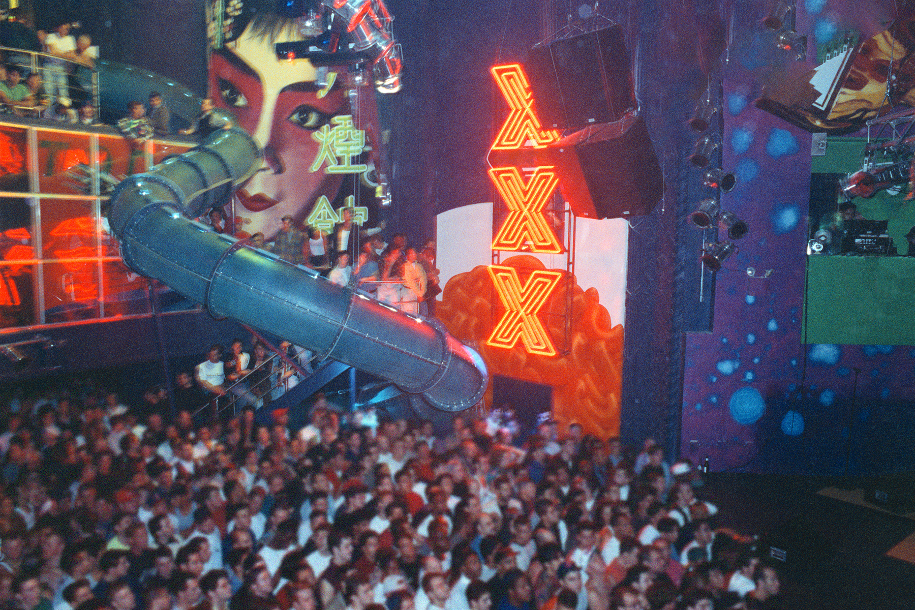 Main dance floor with mezzanine slide at Club USA, 1992.